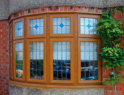Windows – Stylish PVC-U Bay Window in Golden Oak Finish